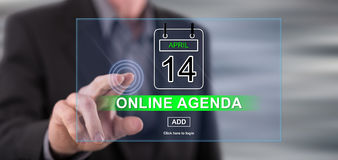 Man touching an online agenda concept on a touch screen Royalty Free Stock Images