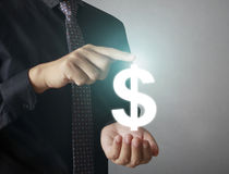 Man touching online button with money icon. Money concept Stock Photos