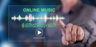 Man touching an online music concept on a touch screen. With his finger royalty free stock images