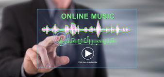 Man touching an online music concept on a touch screen. With his finger royalty free stock photo