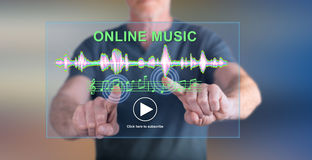 Man touching an online music concept on a touch screen. With his finger royalty free stock image