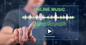 Man touching an online music concept. On a touch screen with his finger royalty free stock photography