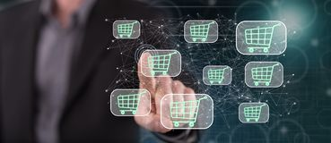 Man touching an online shopping concept. On a touch screen with his finger royalty free stock photo