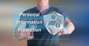 Man touching a personal information protection concept on a touch screen. With his fingers Stock Image