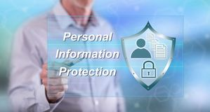 Man touching a personal information protection concept. On a touch screen with a pen royalty free stock photography