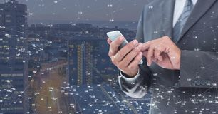 Man touching phone against Night city with connectors. Digital composite of Man touching phone against Night city with connectors Stock Images
