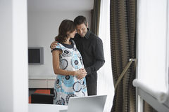 Man Touching Pregnant Woman's Belly Royalty Free Stock Photo