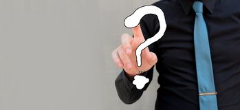 Man touching question mark with tip of his finger. Innovation and inspiration stock photo
