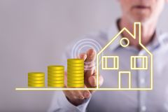Man touching a real estate investment concept stock photography