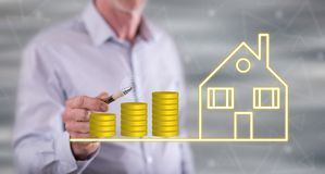 Man touching a real estate investment concept stock images