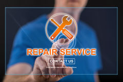 Man touching a repair service concept on a touch screen. With his finger Stock Photo