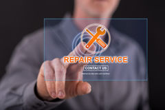 Man touching a repair service concept on a touch screen. With his finger Royalty Free Stock Photos
