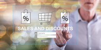 Man touching a sales and discounts concept. On a touch screen with his finger stock images