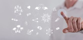 Man touching share symbols on a touch screen Royalty Free Stock Images