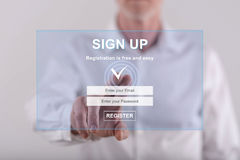 Man touching a signup concept on a touch screen Stock Photos