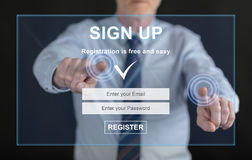 Man touching a signup concept on a touch screen Stock Image