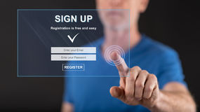 Man touching a signup concept on a touch screen Royalty Free Stock Photo