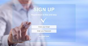 Man touching a signup concept on a touch screen Stock Photography