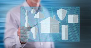 Man touching a smart home concept. On a touch screen with a pen stock images