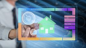 Man touching a smart home concept. On a touch screen with his finger stock photography