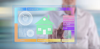 Man touching a smart home concept on a touch screen. With his finger Royalty Free Stock Photos