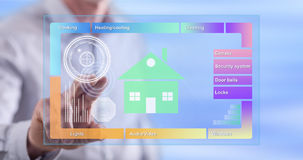 Man touching a smart home concept on a touch screen Stock Photos