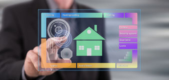 Man touching a smart home concept on a touch screen Stock Image