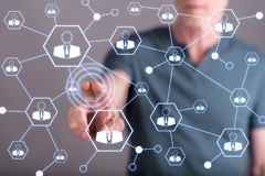 Man touching a social network on a touch screen Stock Photo
