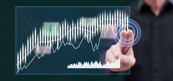 Man touching a stock market concept royalty free stock photo