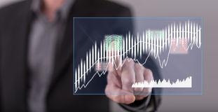 Man touching a stock market concept on a touch screen Stock Images