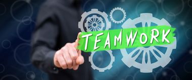 Man touching a teamwork concept. On a touch screen with his finger royalty free stock photography