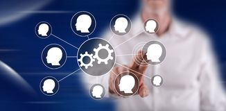 Man touching teamwork concept. On a touch screen with his finger royalty free stock photo
