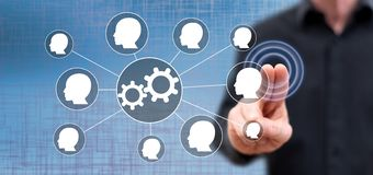 Man touching teamwork concept. On a touch screen with his fingers royalty free stock images