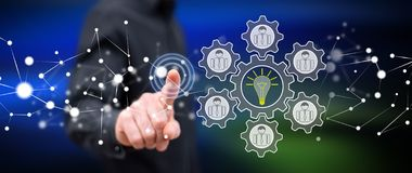 Man touching a teamwork idea concept. On a touch screen with his finger royalty free stock image