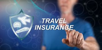 Man touching a travel insurance concept. On a touch screen with his finger stock images