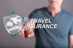 Man touching a travel insurance concept on a touch screen. With his finger Stock Images