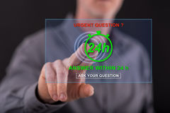 Man touching an urgent questions concept on a touch screen Royalty Free Stock Image