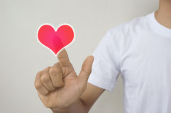 A man touching virtual heart shape buttons Royalty Free Stock Images