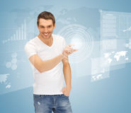 Man touching virtual screen Stock Image