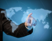 Man touching virtual world map. By hand Royalty Free Stock Photography