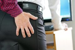 Man touching woman`s butt stock photos