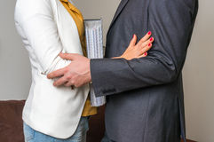 Man touching woman`s elbow - sexual harassment in office Royalty Free Stock Image