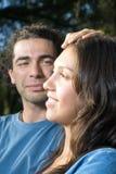 Man Touching Women's Head - Vertical Royalty Free Stock Photo