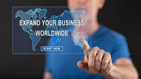 Man touching a worldwide business development concept on a touch screen. With his finger royalty free stock image
