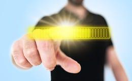 Man touching yellow glowing progress bar on translucent touch screen interface royalty free stock image
