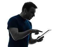 Man touchscreen digital tablet anxious  silhouette Stock Photo