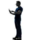 Man touchscreen digital tablet  silhouette Stock Photo
