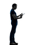 Man touchscreen digital tablet  silhouette Royalty Free Stock Photos