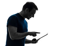 Man touchscreen digital tablet  silhouette Stock Photography