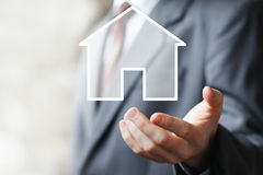 Man with touchscreen house icon sign Royalty Free Stock Images